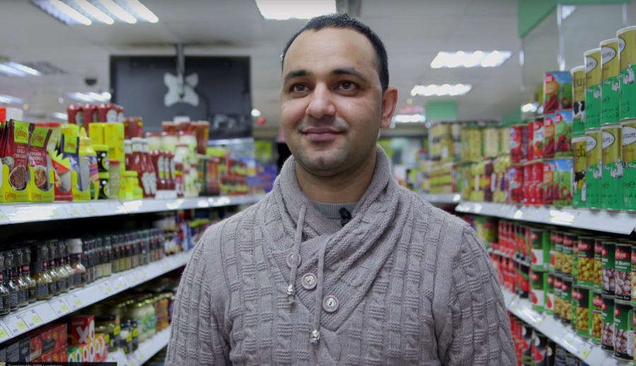 portait picture of an asian shop owner